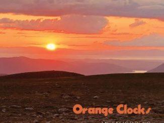 Orange Clocks Cover