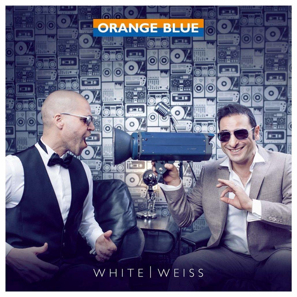Orange Blue mit Doppelalbum in englischer und deutscher Sprache